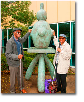 Patrons sample one of the sculptures at the New Jersey State Library Talking Book and Braille Center on Snapshot Day